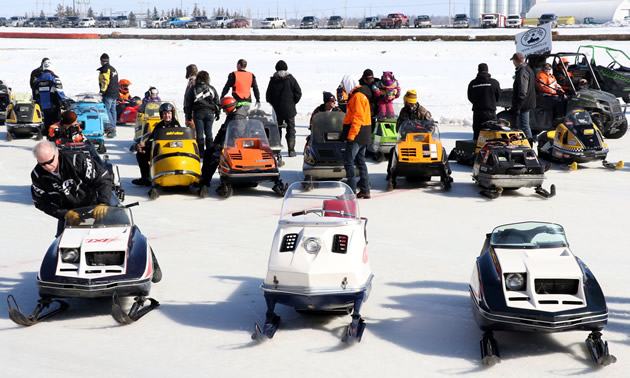 Vintage snowmobile owners prepare for the Canadian Power Toboggan Championships parade.