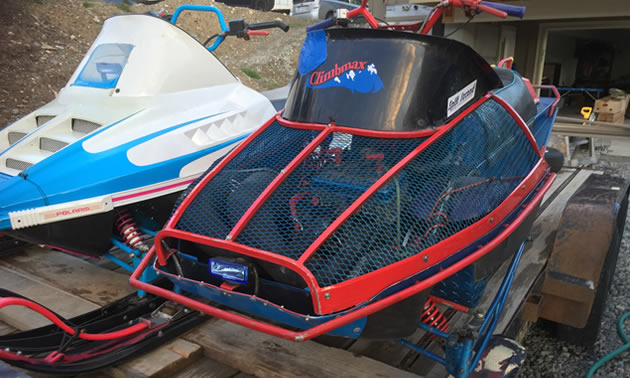 Side view of sled, painted black and red.