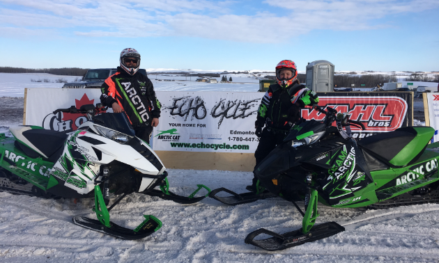 Cory Carter and his wife, Jennifer O'Connor, posing with their snowmobiles after the Lloydminster drag races where they took home nothing but first-place finishes.