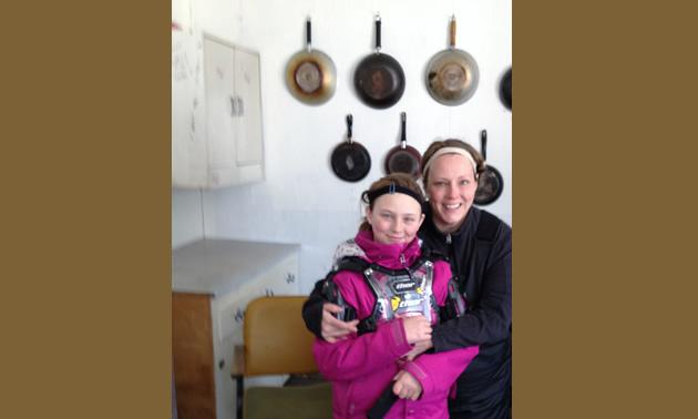 Erik Foster's daughter, Makenna, and his wife, Heather, enjoying the Saskatoon Snowmobile Club's warm up shelter.