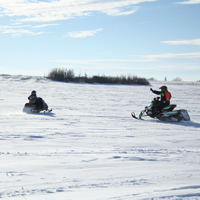 Erik Foster and his son, Kaine, sledding near Colonsay.