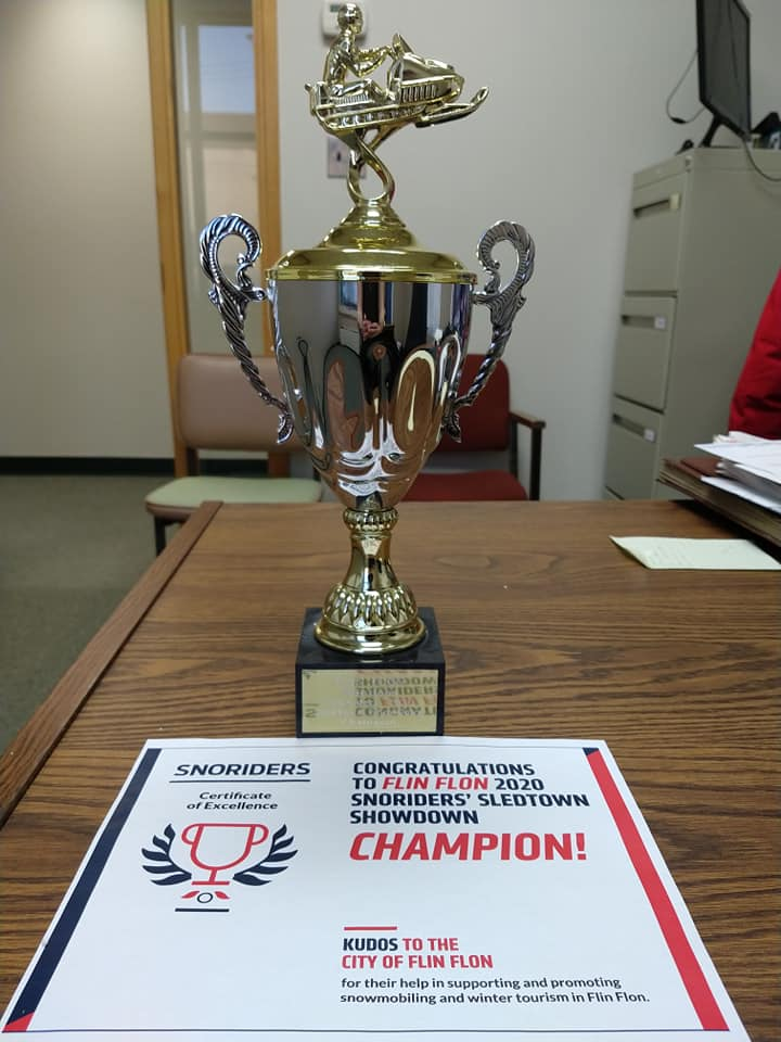 The SledTown ShowDown trophy on a desk in an office.