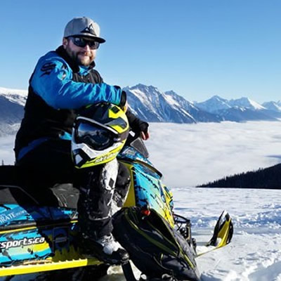 Curt Pawliuk of Valemount posed on his sled on top of mountain.