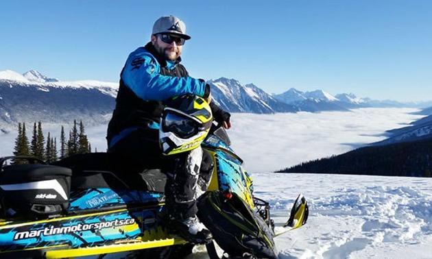 Curt Pawliuk of Valemount posed on his sled on top of mountain.