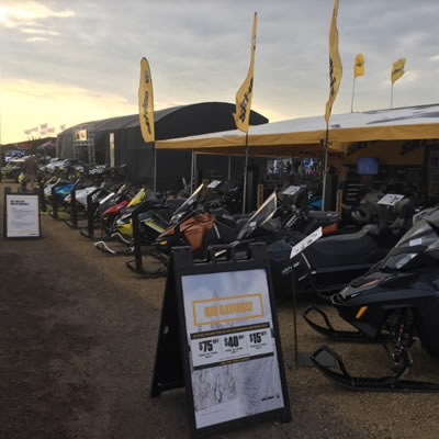 Picture at Hay Days, showing row of snowmobiles.