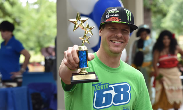 Tucker Hibbert shows off a first place trophy for the team's efforts at the Make-A-Wish event in Minnesota.