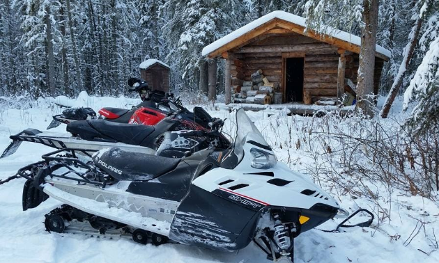 Take a break at one of the snowmobile club cabins, before hitting the trails again.
