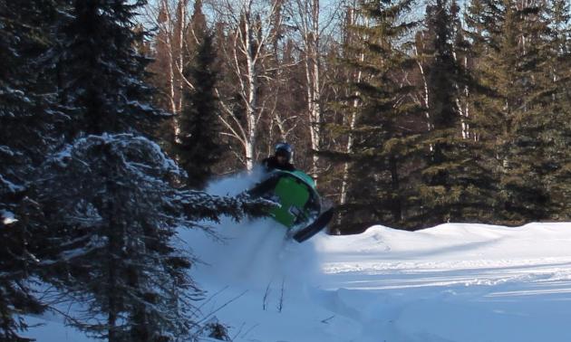 Danny jumps the stump.