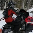 Man on a snowmobile in snow