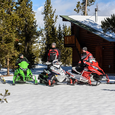 Group of people going out snowmobiling.