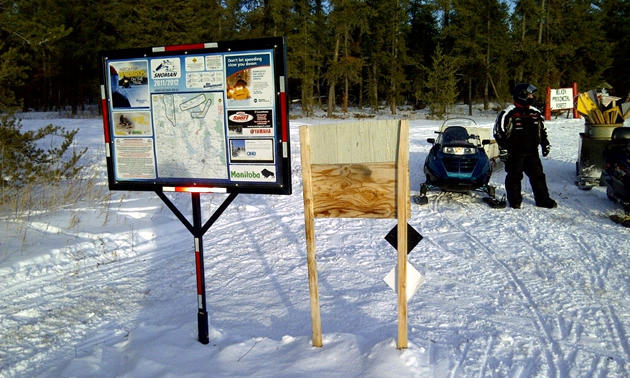 A poster board with trail map made by the Manitoba's Snoman club. Their new map is interactive. They have over 150 of these guide posters throughout their trail system.