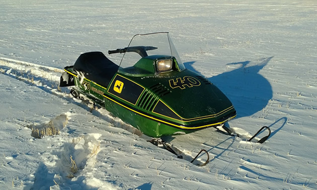 A snowmobile out on a snowy field.