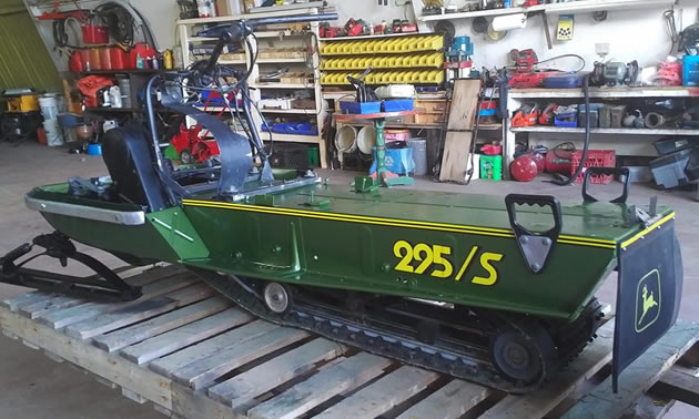 A partially restored John Deere 295/S snowmobile.