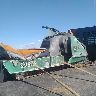 The John Deere sled, before being restored.