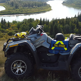 An ATV sitting up on a bank that overlooks the North Saskatchewan River, near Lindbergh.