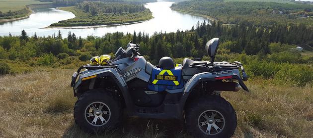 An ATV sitting up on a bank that overlooks the North Saskatchewan River, near Lindbergh.