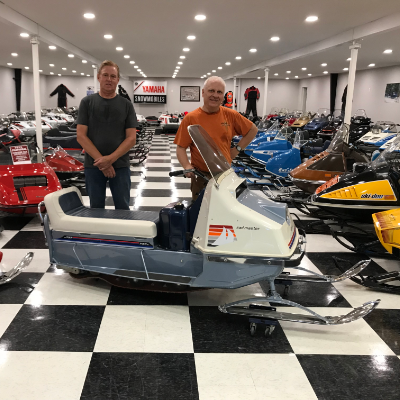 (L to R) Lorne Larson and Valdy Stephonson, president of the America Vintage Snowmobile Association, pose with a 1966 prototype Evinrude Sail Master.
