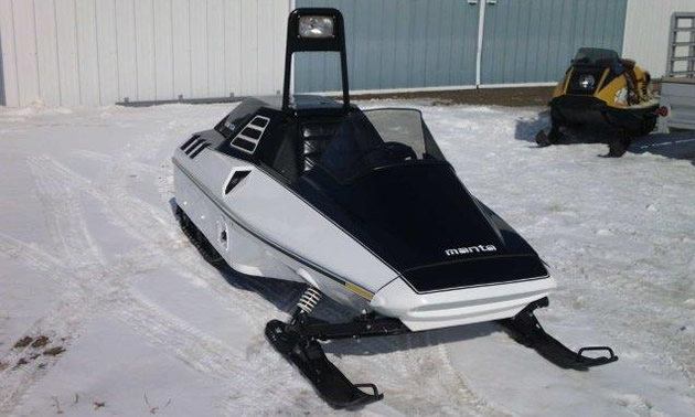 1984 Manta sled, black and white in colour.