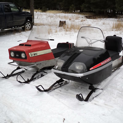 A vintage Mercury sled and a Ski-Whiz sled.