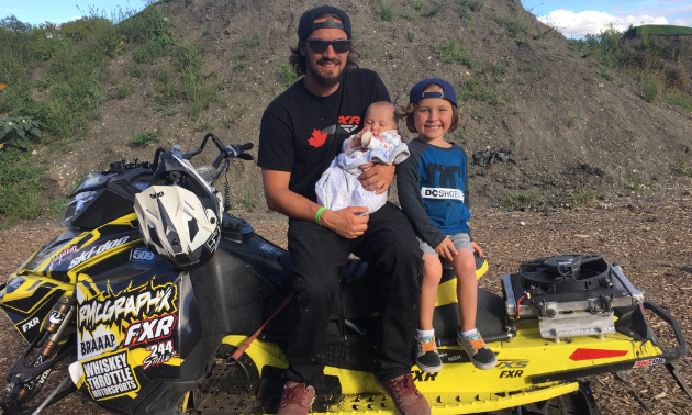 Poirier with his two kids, who love to watch him flying off the ramps.