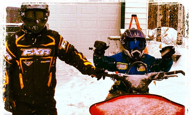Nathan Simpson and son Dominic on a 2001 summit 800 sled named Stella