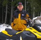 Man and snowmobile