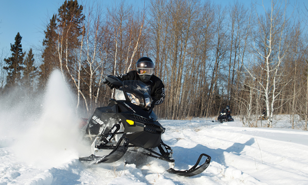 A snowmobiler riding in Nipawin