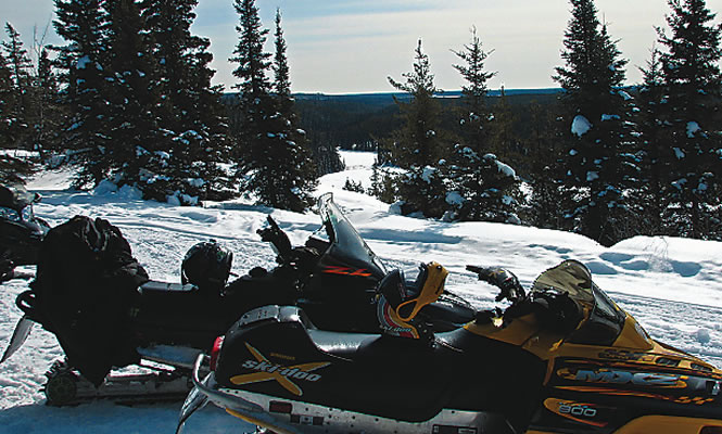 snowmobiles parked in a winter landscape