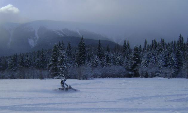 Rad rider Peter Schlief enjoys the mountain backdrop.