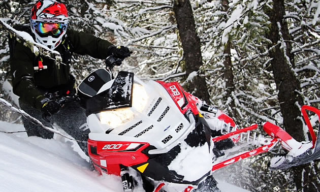 A snowmobiler out in the backcountry.