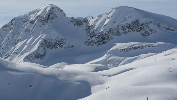 A panoramic view of a snow-covered mountain in the Blue River Powder Packers snowmobile club area