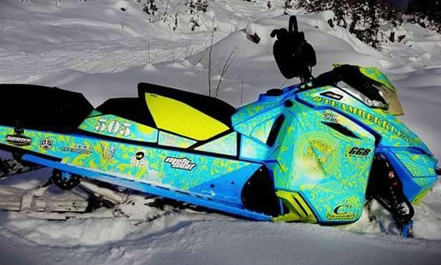A green, blue and yellow sled wrap on a Ski-Doo.