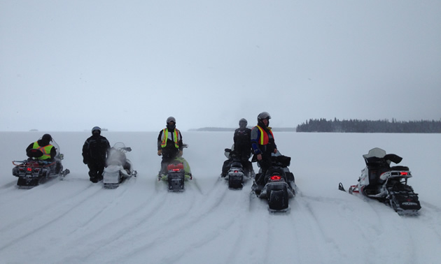 A group of Journey for Sight riders crossing Setting Lake near Wabowden.