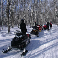 A group of sledders on a trail in Saskatchewan.