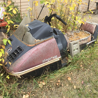 An old Scorpion Stinger 400 sled, spotted in a rural Alberta backyard.