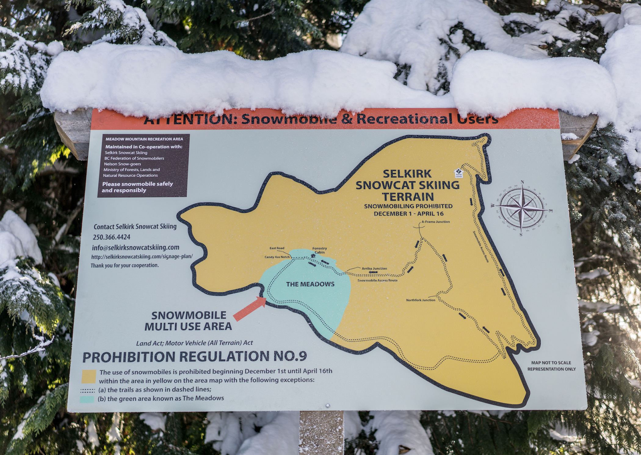 A sign at Selkirk Snowcat Skiing's tenure that shows where skiers and snowmobilers are allowed to recreate.