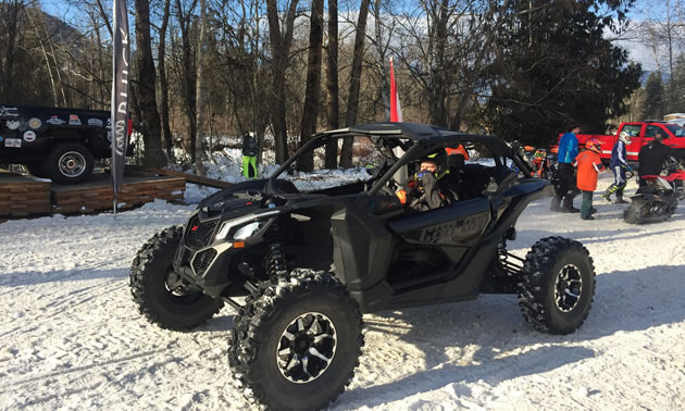 Black ATV on snow racing track