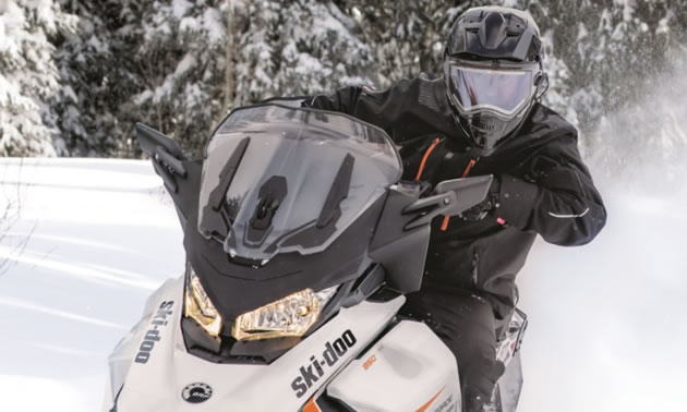 Snowmobile equipped with adjustable windshield.