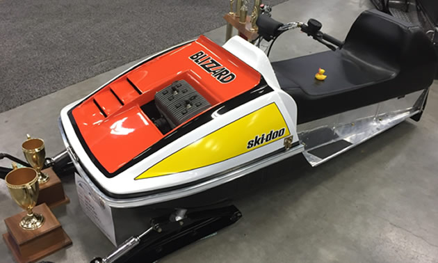 1973 Ski-Doo Blizzard, painted yellow and red.