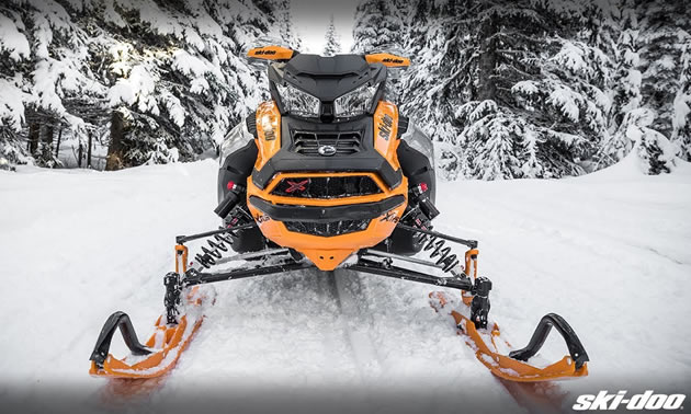 Picture of yellow and black snowmobile.