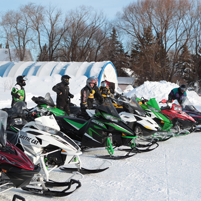 Snowmobilers line up for the Sled for eternity ride in 2015.