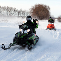 Snowmobilers come down the trail at Manitoba's annual Sled for Eternity event.
