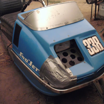 A vintage Sno-Jet sled, powder blue in colour.