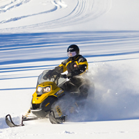 Snowmobiling in the Waskesiu Wilderness Region near Elkridge Resort.