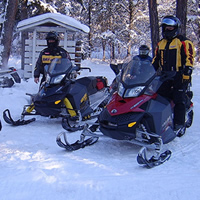 A group of snowmobilers gather in Nipawin Saskatchewan.