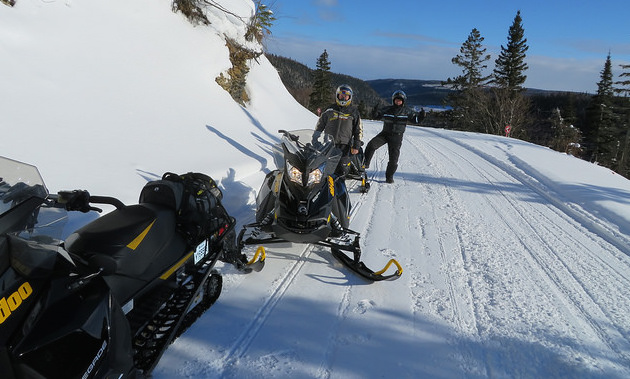 Two riders stopped on a trail near St. Paul, Alberta.