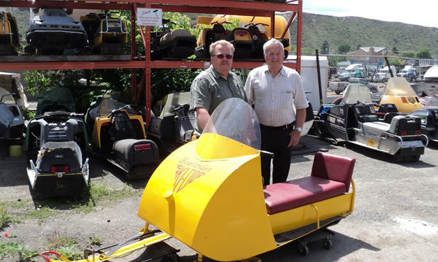Bright yellow tin cab Ski-Doo.