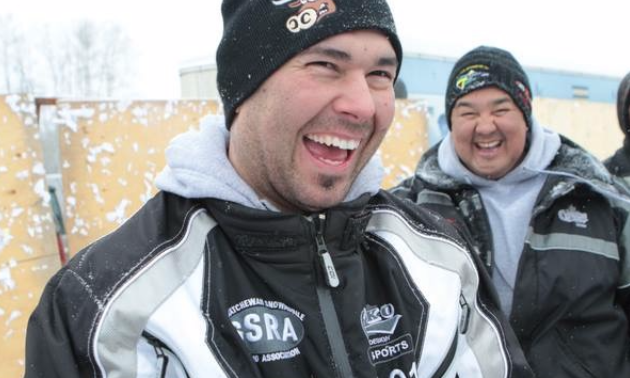 Cory Carter laughing with his pit crew and main sponsor, Shaun Janvier.