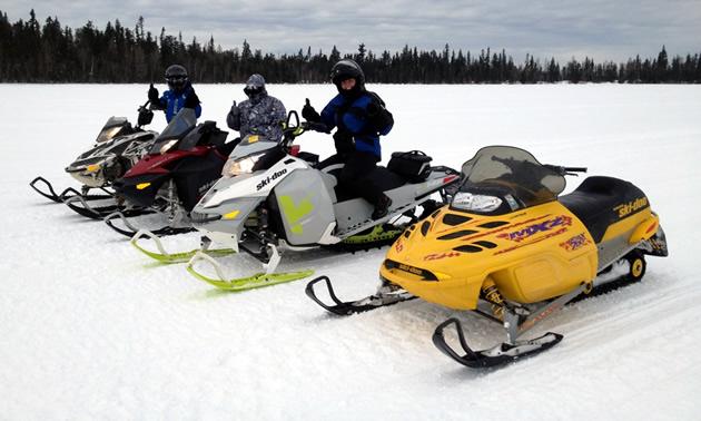 Riders enjoy riding on a lake in the Lakeland Snowmobile club region.
