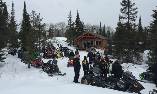 Members of the Whiteshell Snowmobile Club gather for the grand opening of the Swamp Lake warm-up shelter.